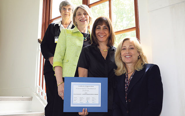 The Jewish Women's Foundation of NJ was recognized in Washington last month as one of six new members of the Philanthropy-Joining Forces Impact Pledge, a nationwide effort to assist service members and veterans. JWF council members, from left, Lesli