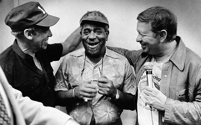 Trumpeter Dizzy Gillespie, center, is flanked by two Jewish musicians, drummer Buddy Rich, left, and singer Mel Torme at the Newport Jazz Festival in 1978.