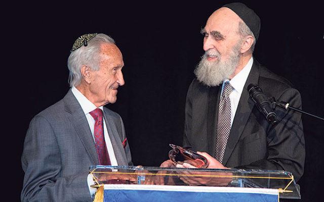 JEC dean Rav Elazar Mayer Teitz presents the Lev Tov Award to Ed Mosberg.