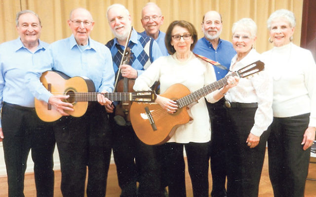 Eight of the nine Jewbadors who will perform at the Jewish Heritage Museum of Monmouth County, from left, Jerry Katcher, Jack Gelfand, Jerry Yochelson, Jonathan Schwartz, Myra Cohen Klenicki, Ed Lazarus, Elaine Schaffer, and Gloria Fink. This photo was ta