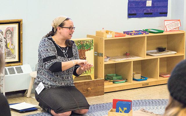 At the Jewish Montessori Society conference, Netivot head primary teacher Adi Yarmush demonstrates a Hebrew language lesson.