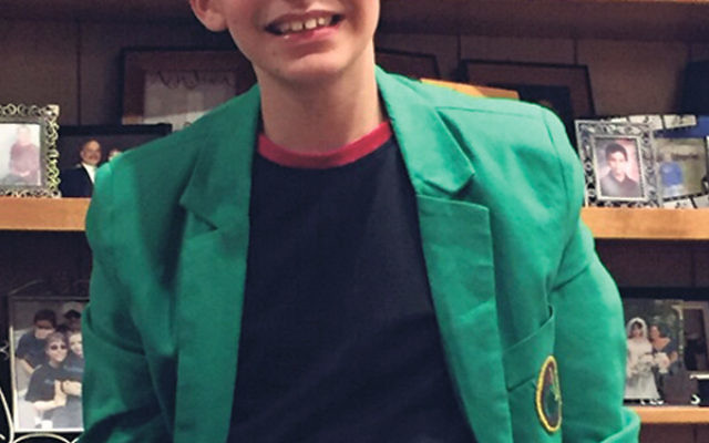 Jonathan Wiener, wearing his Masters green jacket; a team of educators, clergy, therapists, and family members supported him in preparation for his bar mitzva.