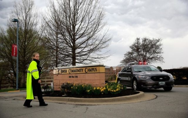 A police officer and squad car are seen at the entrance of the Jewish Community Center in Overland Park, Kan., following the fatal shootings there, April 13, 2014. (Jamie Squire/Getty Images)