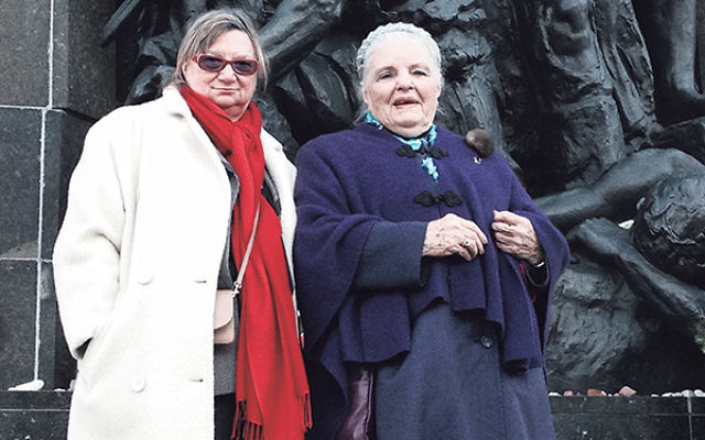 Holocaust survivor Luna Kaufman, right, with Nina Wolmark, daughter of famed sculptor Nathan Rapoport, whose Warsaw Ghetto Monument served as a focal point during the opening ceremonies of the new Polin Museum of the History of Polish Jews in Warsaw.&nbsp