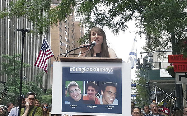 Gabrielle Flaum, 22, of Millburn, founder of the teen advocacy movement Save Our Soldiers (S.O.S.), addresses the 1,000 people who came to the Solidarity Rally with Israel in support of the three kidnapped boys, June 24 in front of the Israeli consulate i