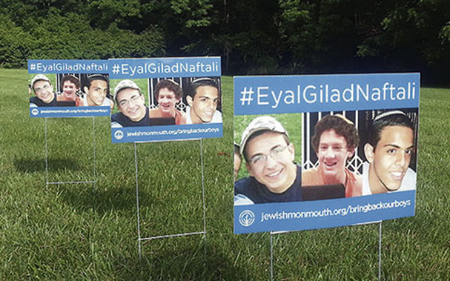 Lawn signs, produced by the Jewish Federation of Monmouth County, are part of the campaign to raise awareness of the kidnapped Israeli teenagers.