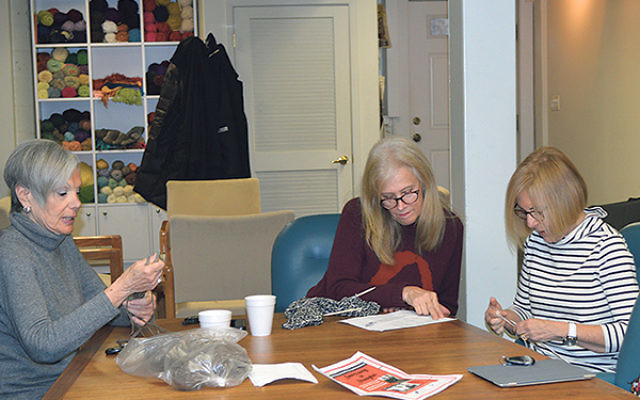 Members of the Knitting Circle, from left, Ann Fitilis, Shelley Rosenthal, and Susan Schaffer concentrate on their craft.
