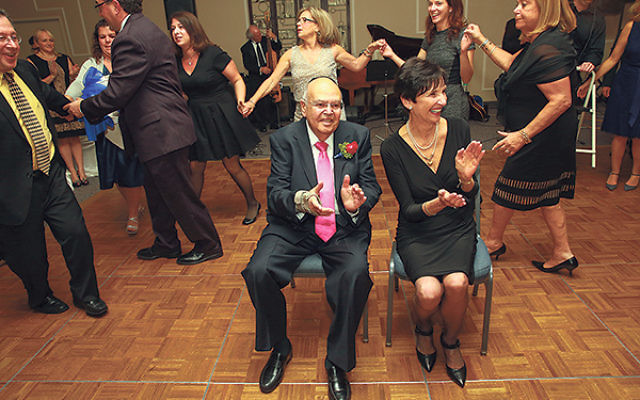 Cantor Jack Korbman and his wife, Barbara, are at the center of a celebratory dance at the gala held on the occasion of his retirement on Dec. 5.