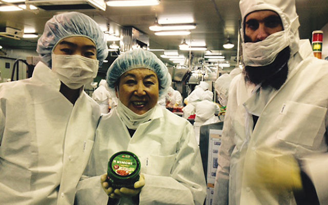 Ziporah Rothkopf, center, at what she says is the only kosher kimchee factory in South Korea. Rabbi Osher Litzman, at right, is the mashgiach and religious leader of the Chabad Jewish community of Korea, headquartered in Seoul.