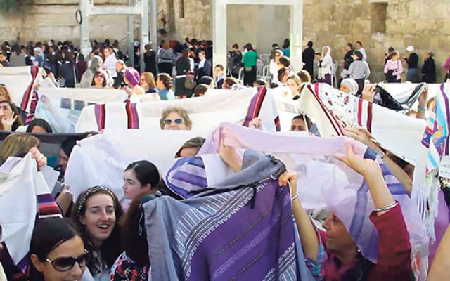 At the Kotel in Jerusalem on Nov. 4, 2013, Women of the Wall don their tallitot to pray and celebrate the 25th anniversary of the organization.