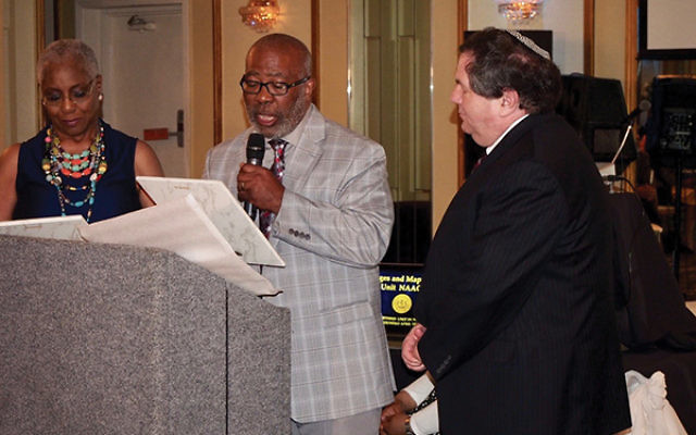 """Rabbi Clifford Kulwin of Temple B'nai Abraham, right accepts an award from Tom Puryear, president of the Oranges and Maplewood Unit of the NAACP. Kulwin and the congregation were cited for """"ensuring that activities on behalf of civil rights fo"""