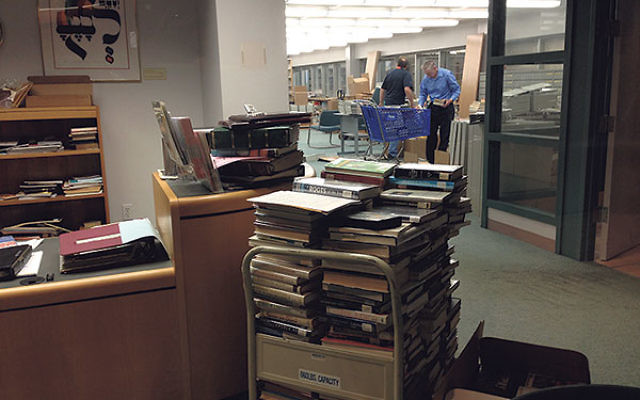 Maintenance workers began dismantling shelves in the Waldor Library in June.