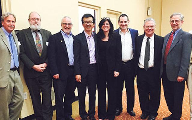 Labor Seder organizers and speakers, from left, Jeff Stile, Arieh Leibowitz, Kevin Brown, Samuel Chu, Melanie Roth Gorelick, Mark Dunec, Martin Schwartz, Ira Stern, and Bennett Muraskin.
