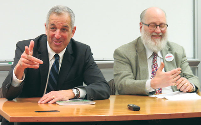 Employment lawyer Bruce Gitlin, left, and labor lawyer Bennett Zurofsky tell Rutgers law students their careers are rewarding in keeping with their Jewish sense of justice.