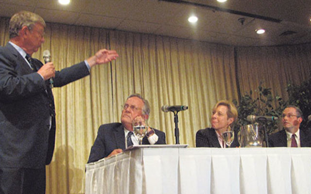 Moderator Jeff Greenfield, standing, in discussion with panelists, from left, retired judge John Bissell, lawyer Nancy Erika Smith, and rabbinic judge Rabbi Daniel Rapp at the Sept. 22 Jewish Law Symposium in Whippany.