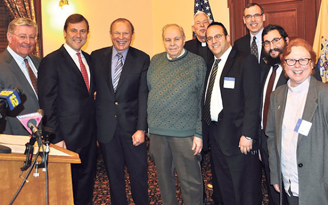 At the gathering in Trenton announcing the formation of Faith Leaders Against Violence are, from left, Patrick Brannigan, State Sen. Tom Kean, State Sen. Raymond Lesniak, Deacon John Tominicki, the Rev. Bruce Davidson, Rabbi Avi Schnall, John Rosen, Rabbi