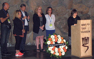 Laying a memorial wreath at Yad VaShem are, from left, Roy Tanzman, Brenda Tanzman, Mark Levenson, Assemblywoman Holly Schepesi, Assemblywoman Pamela Lampitt, and docent Malka Weisberg.