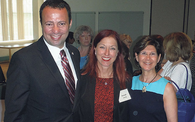 Austrian reparations administrator Hannah Lessing, center, is welcomed by GMW federation executive vice president/CEO Dov Ben Shimon and Women's Philanthropy president Joan Schiffer Levinson at the WP annual meeting.