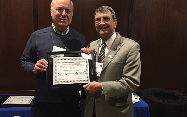 Life & Legacy chair Michael Wasserman, right, presents a certificate to RPRY board member Hillel Raymon in recognition of his service on the school's Life & Legacy committee. Photo courtesy Jewish Federation in the Heart of NJ