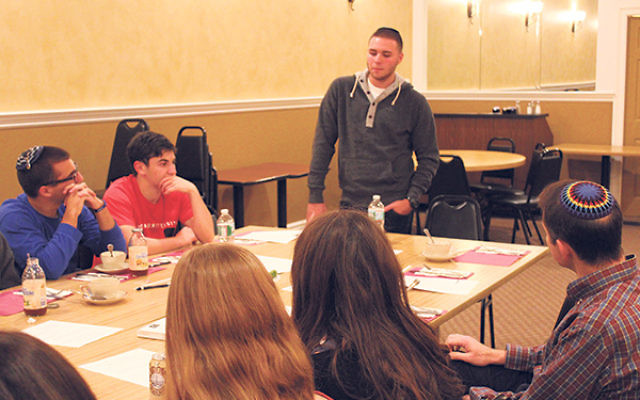 """""""Lone soldier"""" Ben Maruscak tells students at Marlboro Jewish Center about his life as an oleh in Israel."""