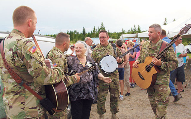 Luna Kaufman is serenaded by an Army quartet following the dedication of The Liberator Tree on July 23.