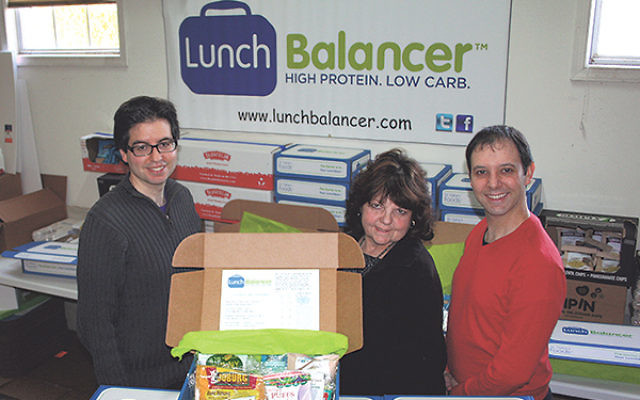 "Dr. Gabe's Foods' Smolarz family team in its ""fulfillment' center"" — mother Sari and sons Shaun, left, and Gabe."