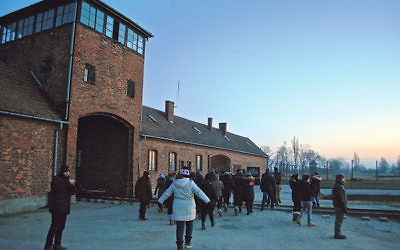Students gather outside the gates of Auschwitz in Poland.