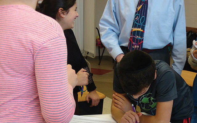 """Shai Goldstein talks to students during a breakout session after they watched a video of the Rev. Dr. Martin Luther King Jr.'s historic """"I Have a Dream"""" speech."""