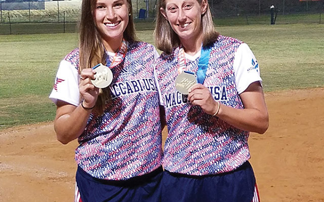 Nicole Arias, right, softball head coach at the Maccabiah Games, with her former pitcher from Princeton University, Claire Klausner. Photo by Rebecca Arias