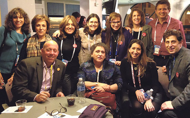 Among the AIPAC policy conference delegates at a reception sponsored by the Jewish Federation in the Heart of NJ are executive director Keith Krivitzky, front row, far left, and Alexa Silverman, director of AIPAC's NJ Region, third from left; and Ra