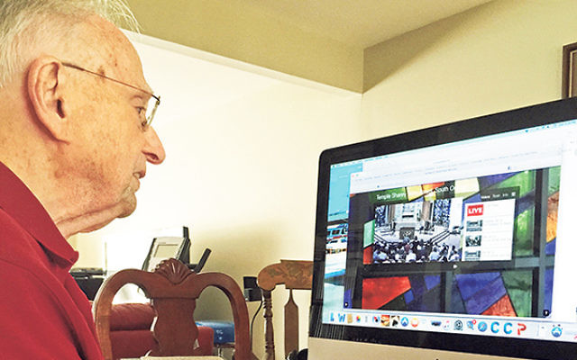 Murray Mankowitz, who can no longer drive to Temple Sharey Tefilo-Israel to attend services, stays connected via live streaming video.