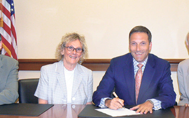 Signing on to the AJC's Mayors United Against Anti-Semitism statement are, from left, AJC NJ Area director John Rosen, Essex County Freeholder Patricia Sebold, Livingston Mayor Michael Silverman, and AJC NJ Legislative Advocacy Committee cochair Art
