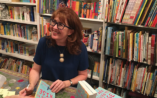 """Laura McBride at a book signing event at Watchung Booksellers in Montclair last May; both """"'Round Midnight"""" and her previous novel, """"We Are Called to Rise,"""" were featured. Photo courtesy Laura McBride"""