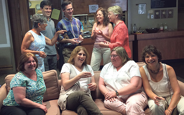 "At an Aug. 16 ""meet and greet"" for Rabbi Marsha Friedman, seated, second from left, are, from left, seated, Joan Sanchez, Betsy Stern, and Marsha Rudolph, and, standing, Meryl Miller, Evan Yassky, Brian Tucker, Sharon Mizels, and Ann Harwood."