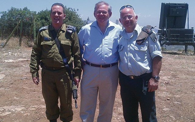 In May 2013, Sen. Robert Menendez, center, visited the site in northern Israel of a battery of the Iron Dome missile-defense system with military officials, including former IDF deputy chief of staff Yair Naveh, right. Photo courtesy Office of U.S