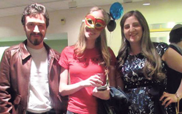 At the Mesorah Purim party in the Zimmerli museum in New Brunswick are, from left, Joey Miller and Alyssa Bree, both of Highland Park, and Jessica Goldberg of Hamilton.