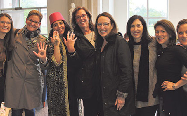 Among the Jewish Federation of Greater MetroWest NJ leaders who joined in the Mimouna — some showing off their henna designs — were, from left, Global Connections manager Sandy Green, Tsafona chair Stephanie Sherman, shliha Moran Shevach, Tsaf