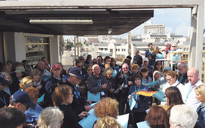 Keith Krivitzky, far right, welcomes members of the federations' mission to a ceremony overlooking the Old City of Jerusalem.