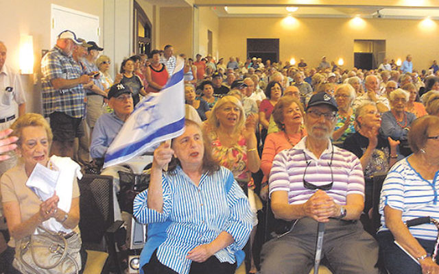 During a solidarity gathering for Israel in Monroe, almost 600 people turned out to sing, dance, pray, and hear firsthand accounts of life in Israel during Operation Protective Edge.