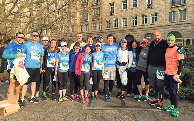 Lee Murnick, fourth from left, and her teammates gather before the Berlin Half Marathon.