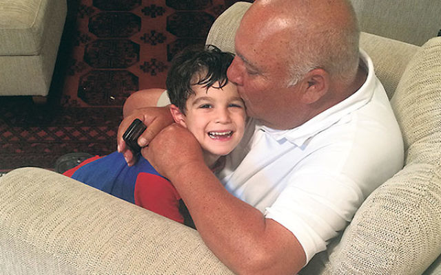 Howard Muser plays with a four-year-old cousin, Yoav Gladstone, during a visit to his visit to his parents' home in Modi'in.
