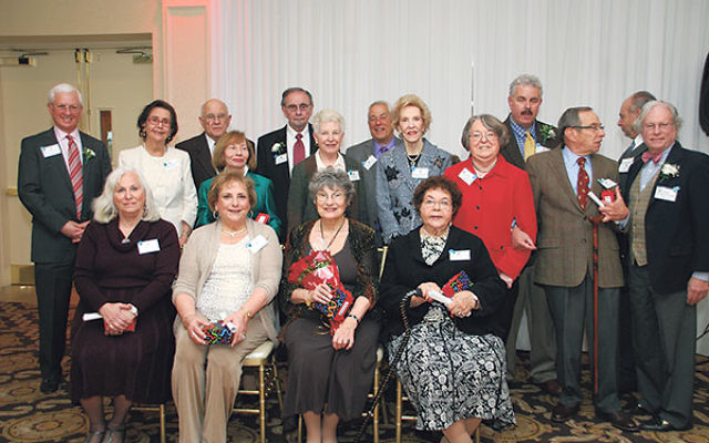 "Honorees at the 10th anniversary brunch, from left, standing, Bernard ""Nardie"" Hochberg, Barbara Michaels, Sid Marshall, Gloria Landy, Mel Druin, Caryl Sills, Gary Cohen, Linda Friedman, Rabbi Sally Priesand, Michael Berman, Charles Sills, and"