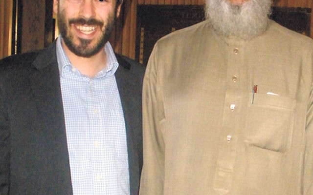 Temple Emanu-El's Rabbi David Vaisberg, left, is joined by Imam Raouf Zaman of the Muslim Center of Middlesex County during the last of three dialogues between members of the two religious institutions.