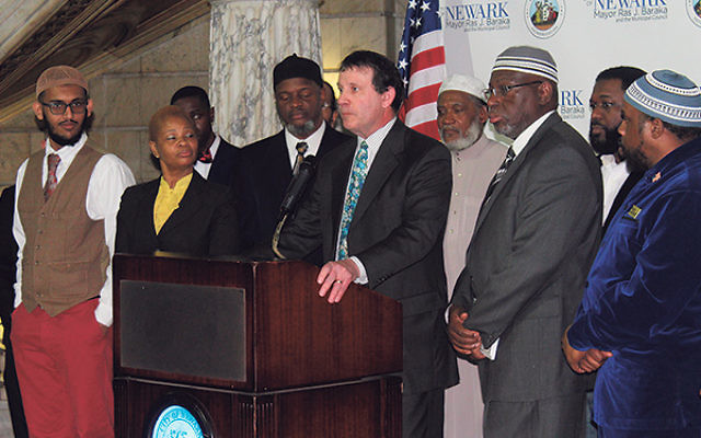 """Flanked by Christian and Muslim clergy members, Rabbi Simon Rosenbach of Ahavas Sholom told a Newark City Hall press conference decrying anti-Muslim violence that """"the Torah tells us to love the stranger."""""""