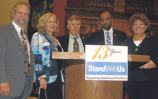 At Congregation B'nai Tikvah in North Brunswick are Kasim Hafeez, second from right, and, from left, Rabbi Robert Wolkoff; program chair Naomi Vilko; and Joseph Puder and Ferne Hassan, executive director and associate executive director, respectivel