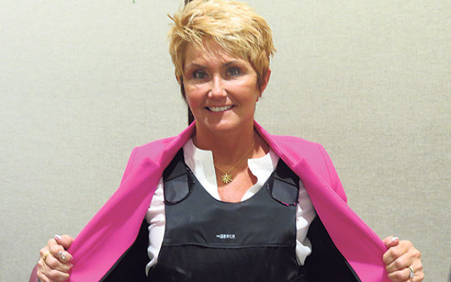Clinton Mayor Janice Kovach shows a bulletproof vest like those worn by many fearful abortion providers.