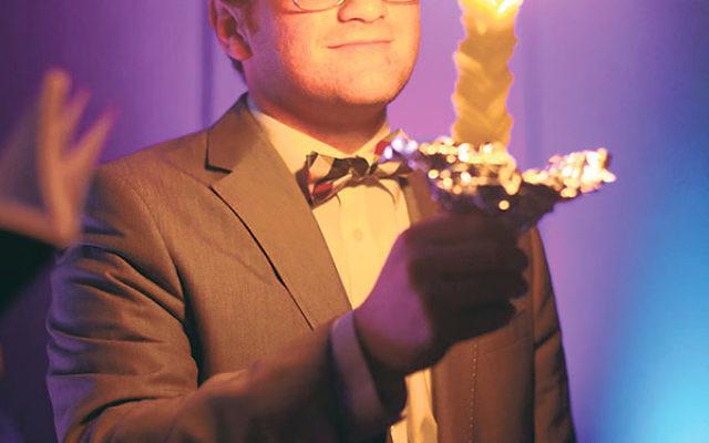 Elliot Englard celebrates Havdala at an NCSY spring regional convention held Memorial Day weekend in Stamford, Conn.