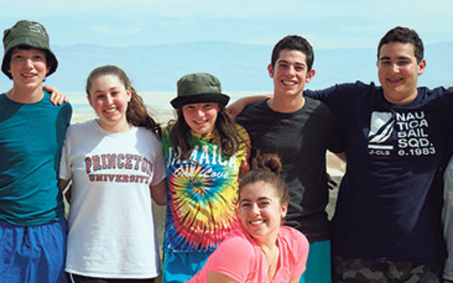 At the base of Masada are NJ teens participating in the NFTY-EIE High School in Israel program, from left, Nate Perlmeter, Isaac Hart, Erika Lilienfeld, Zoe Dressner, Jacob Feldstein, Stephan Rosen, and Samantha Saunders; in front, Iris Hirsch.
