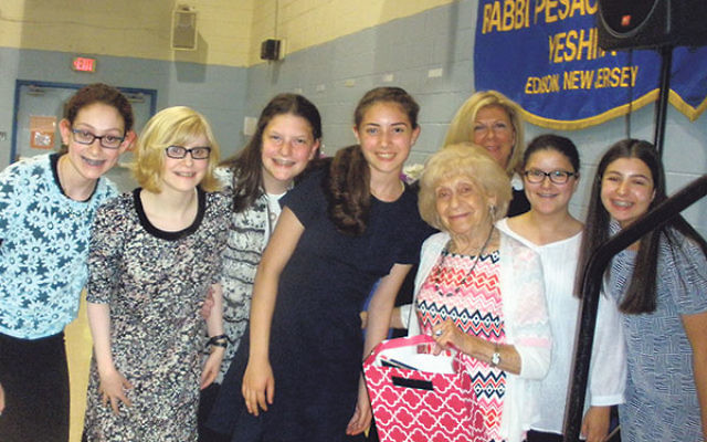 Holocaust survivor Fay Baumfeld with the RPRY student team who interviewed her.