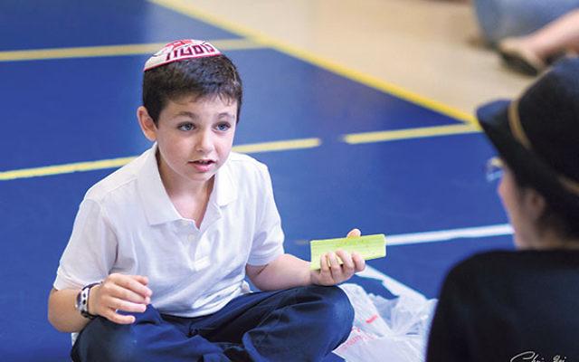 Third-grader Jake Zucker-Levine teaches about the solar system.